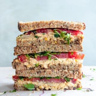 stacked vegan chickpea salad sandwich