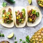 Marinated vegan asada mushroom tacos with pineapple salsa, avocado, jalapenos, and cilantro