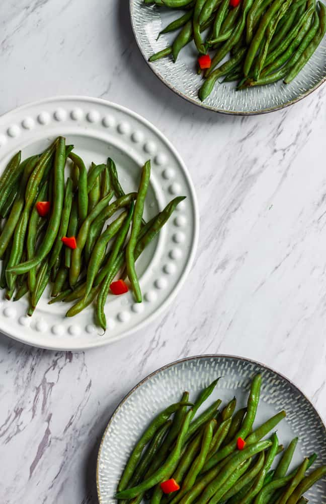 three plates of green bean for thanksgiving