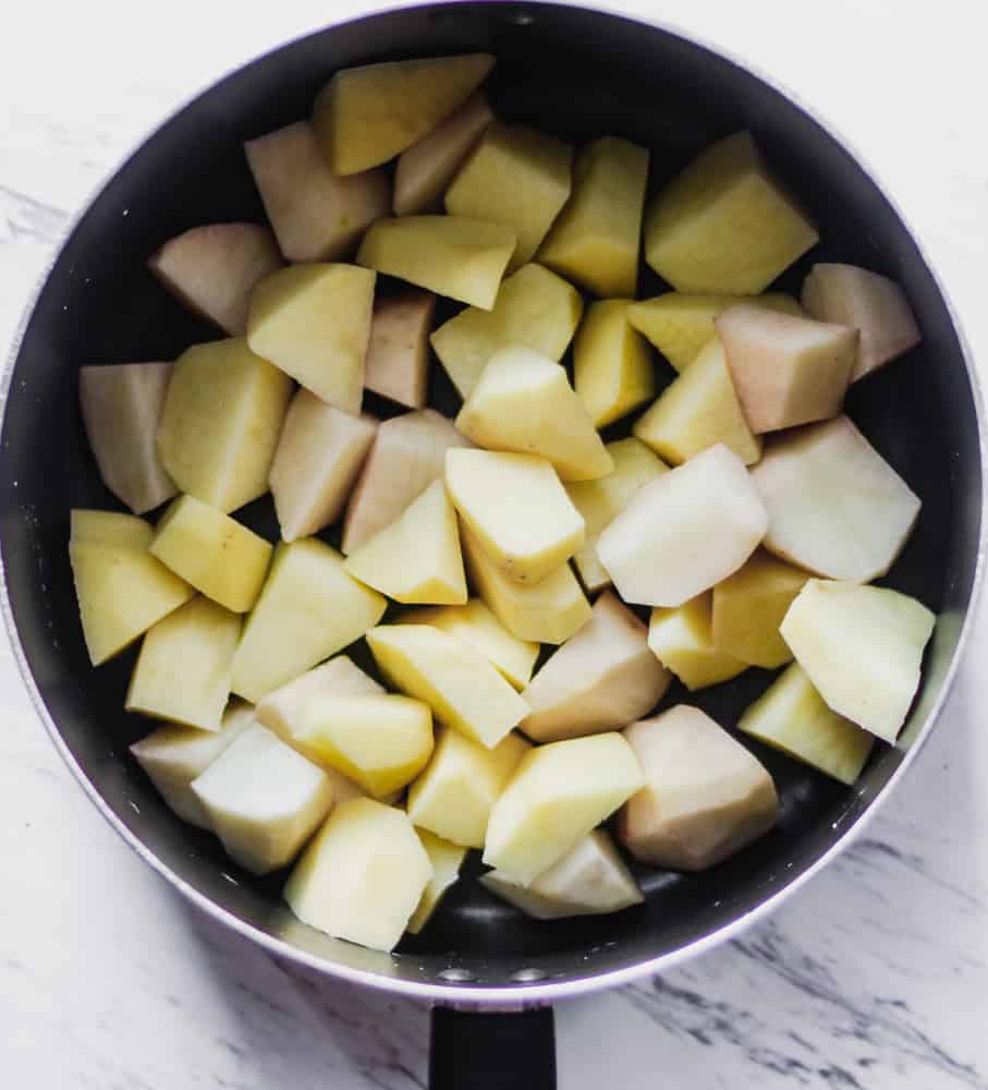 a pot of diced yukon gold and russet potatoes