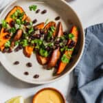 baked sweet potato fries with black beans and cilantro and siete cashew cheese