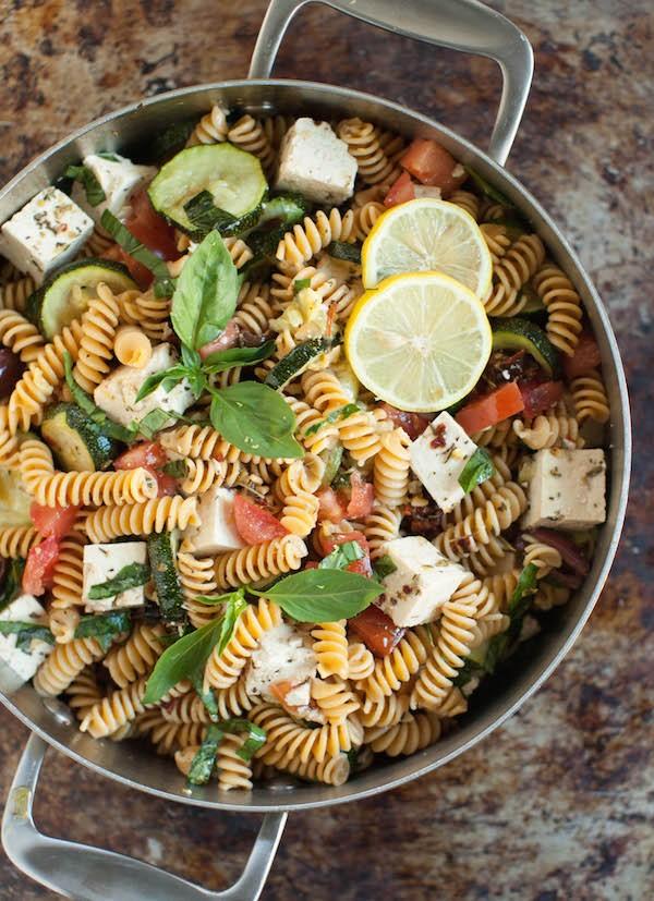 mediterranean pasta salad recipe with chickpea pasta. basil, lemon, tomatoes, olives, zucchini squashes, tofu, red wine vinegar