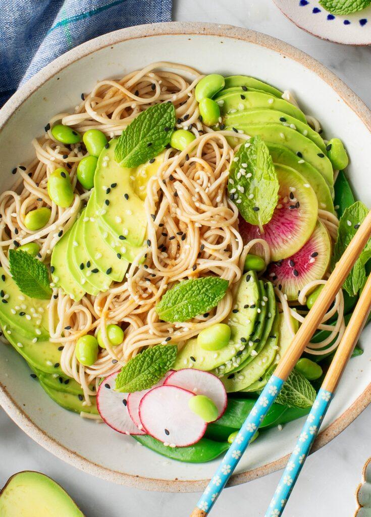 soba noodles with sesame seeds, mint, edamame, radishes, watermelon radish and avocado