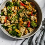 tempeh, broccoli, bell peppers, cauliflower in jerk seasoning